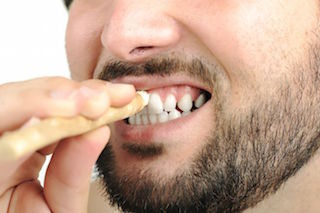 man-cleaning-teeth-miswak-stick.jpg.653x0_q80_crop-smart